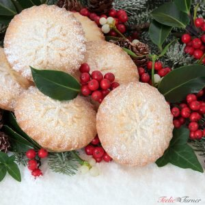 Christmas mince pie cakes with holly, ivy, mistletoe and snow co