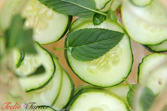 Cucumber water in the transparent pitcher - background