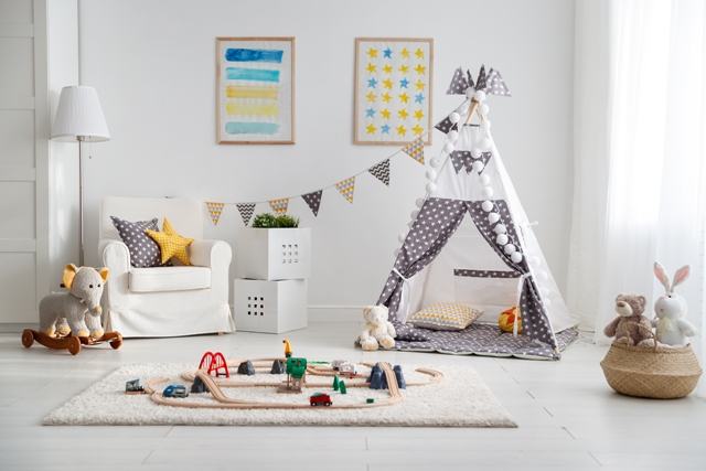 an empty children's playroom with ent and toy railway